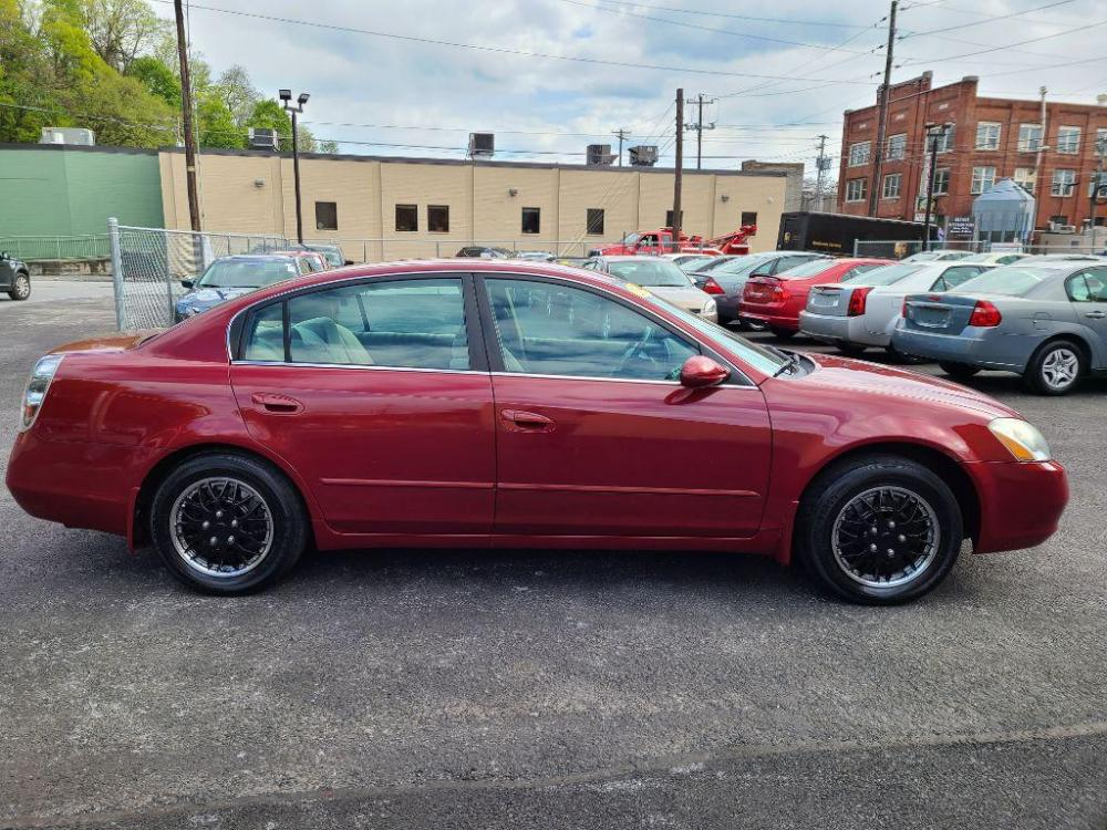 2004 RED NISSAN ALTIMA BASE (1N4AL11D04C) with an 2.5L engine, 4-Speed Manual transmission, located at 131 North Cameron Street, Harrisburg, 17101, (717) 257-0766, 40.266991, -76.875137 - Photo #5