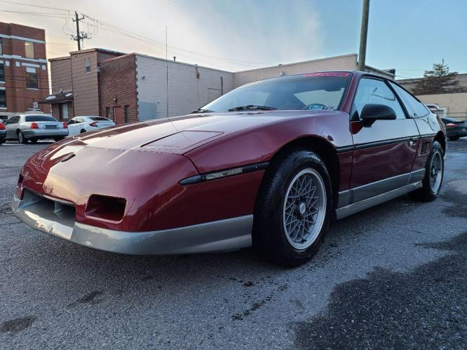 1987 RED PONTIAC FIERO GT (1G2PG1192HP) with an 2.8L engine, Automatic transmission, located at 131 North Cameron Street, Harrisburg, 17101, (717) 257-0766, 40.266991, -76.875137 - Photo #0